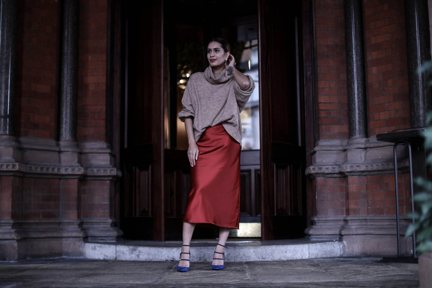 Reena Rai wearing THAT sold out Topshop skirt with Nicholas Kirkwood heels and a nude jumper at the St Pancras Renaissance hotel